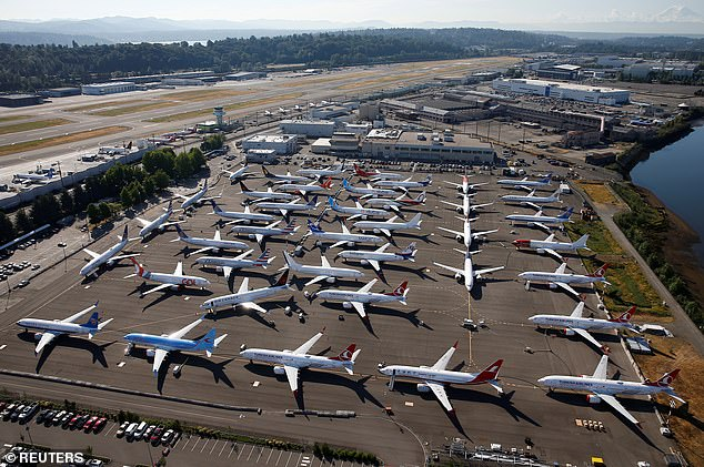 Boeing's 737 MAX is not expected to return to service until January 2020. The grounded aircraft is seen parked in an aerial photo at Boeing Field in Seattle, Washington, in July